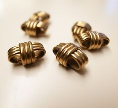 30 Vintage thick brass beads small size knot design with lines texture box shape 12x8mm heavy. $15.00, via Etsy.