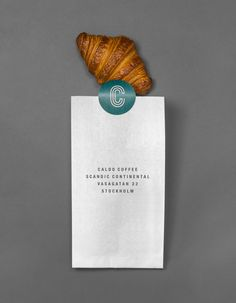 Logo and bakery packaging designed by for Stockholm cafe Caldo Coffee at the Scandic Continental Bakery Branding, Bakery Packaging, Bakery Logo Design, Wine Packaging, Food Packaging Design, Brand Packaging, Logo Branding, Brand Identity, Branding Design