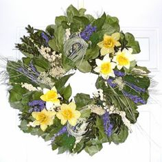 This lovely silk and dried flower wreath exudes springtime with its quailbrush twig base accented with yellow and white mini silk daffodils as well as pearly everlasting, preserved basil salal and dark blue larkspur. Fall Mesh Wreaths, Twig Wreath, Christmas Wreaths, Floral Wreath, Spring Wreaths, Door Wreath, Dried Flower Wreaths, Dried Flowers, Silk Flowers