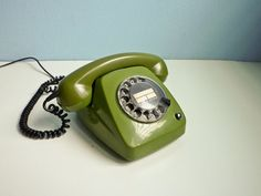 Vintage dial bell telephone, super green color, good vintage condition, comes from the 70s.    Really perfect for display and for use, previous owner told me that is working but i don't have a line to test it.  Has a small crack behind as visible in picture 4 that don't affect the general good looking.    A really nice european design object for decorating your room.  Sure uncommon outside Europe.    Simply ask for more pics or info if u're interested.