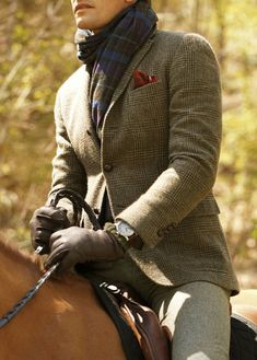 Tweed - not sure if it's the clothes, or just the fact he's riding a horse! LOL!