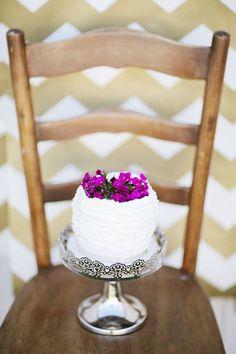 Tiny ruffled cake adorned with fuchsia flowers   Photo by Happy Confetti Photography