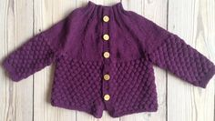 My most recent knit. I adore the plum color and sailor bump pattern of this baby cardigan - it's a girl, but not a girly girl :-)