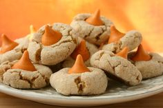 Cinnamon Pumpkin Spice Kiss Blossoms--i WILL be making these..and then eating all of them to myself because i have no self control with pumpkin