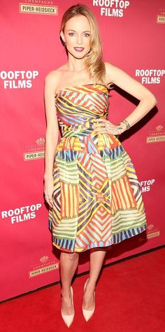 Heather Graham wearing a  multi-colored geo-print Naeem Khan frock, with pale pumps.