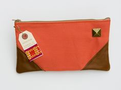 large zipper clutch in neon coral with leather corners