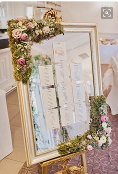 Great idea for escort cards( idea for Brian Laura wedding im thinking guest book signing matte surrounding engagement photo replace with wedding photo the set up on easel st cake table