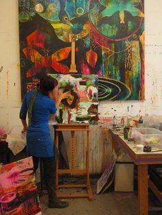 Flora Bowley painting in her studio.