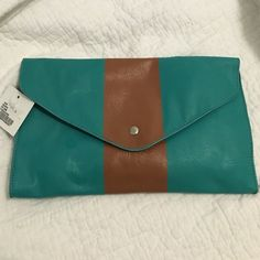 Turquoise and Brown Clutch Turquoise and brown clutch from Francesca's. Silver snap in front. Small detachable strap Francesca's Collections Bags Clutches & Wristlets