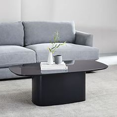 Shape up your space in modern form with our Superellipse Side Table. Standing on a bentwood base that's covered in sleek lacquer, it features a durable, tempered glass top that's back-painted—in other words, you can rest your books and drink… Glass Top Side Table, Black Side Table, Glass Top Coffee Table, Oval Coffee Tables, Reclaimed Wood Coffee Table, Modern Console Tables, Top Interior Designers, Glass Shelves, Furniture Decor