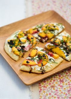 Peach, Goat Cheese, Basil & Balsamic Pizza    ingredients:  1 batch pizza dough (use your favorite recipe, or use mine here)  1 cup balsamic vinegar  2 tablespoons olive oil  8 ounces fresh mozzarella, sliced or grated  2 ounces soft goat cheese, crumbled  4 peaches, pitted and thinly sliced  1/2 cup coarsely chopped basil    directions:  To pr