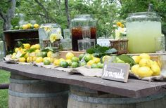 This is a fun way to encourage your guests to stay hydrated! Simply place vintage wine barrels and a few planks close to your outdoor ceremony space to greet your guests. Have your handmade chalk wedding announcement sign in a easel.