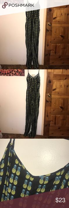 Black jumpsuit, with pineapples Black jumpsuit with pineapples. Pants style and spaghetti straps H&M Pants