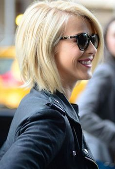 Short, blonde hair.