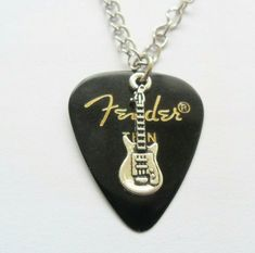 """Black Fender guitar pick necklace silver musical charm with 18"""" inch curb chain #12345market #Charm Guitar Pick Jewelry, Guitar Pick Necklace, Silver Necklaces, Musicals, Music Instruments, Charmed, Pendant Necklace, Chain, Sunday"""