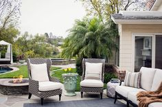 such elegant seating for outside - could I achieve this look with painted wooden/metal chairs with cushions perhaps??