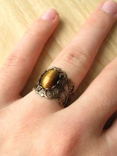 Beautiful silver design with tigers eye. By handmadebybluebird on Etsy.  Wow that is really beautiful!