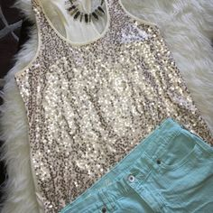 Sequin Racer Back Tank Beautiful sparkly tank to add to any outfit. Worn once, no flaws. All sequins still in tact!  size small but can fit a medium. Express Tops Tank Tops