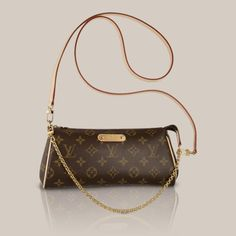 Eva Clutch Monogram Canvas The short golden shoulder chain of the Eva is perfect for evening use, while the wrist carry is another stylish option. The cross shoulder strap offers a more casual look. The perfect clutch for night or day.