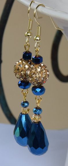 Blue Crystal Teardrop and Gold Pave Clay Rhinestone Disco Beaded Dangle Earrings. Gold Disco Ball Beaded Earrings with Blue Teardrop Beads.
