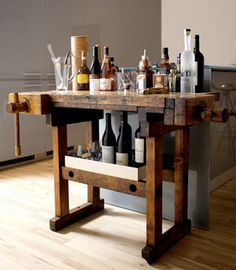 Woodworking table upcycled into bar cart in kitchen Nice! Masculine but not overly so