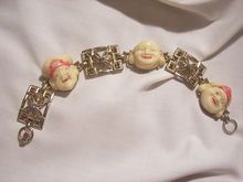 Always something exciting in store 10 to 60 % Off many items saleRare Coro Molded carved Buddha faces rhinestone Bracelet