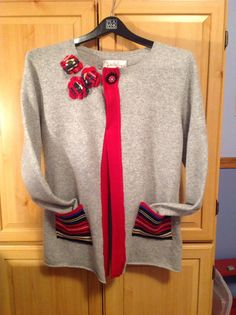 Make a cashmere pullover into a fun cardigan....cut up the front, add cashmere edging, pockets, and flowers! Fun and easy.