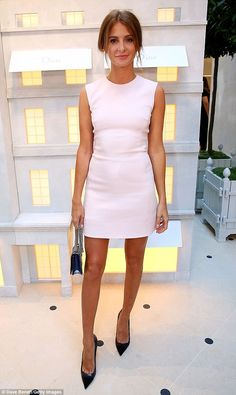 It was an evening in which stylish outfits were aplenty and Millie Mackintosh made sure she was up there with the best of them in the style stakes as she put on a sophisticated display at the House of Dior Boutique Launch Party in London's New Bond Street on Wednesday evening