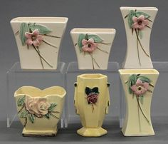 McCoy pottery vases and planters, circa 1940 McCoy pottery vases and planters, circa 1940 : Lot 4216 Mccoy Pottery Vases, Roseville Pottery, Antique Vases, Or Antique, Pottery Marks, Vintage Planters, Vintage Dishes, Vintage Pottery, Pink Flowers