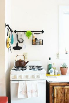 thisoldapt:  Here, IKEA's Fintorp System gets put to work in a tiny kitchen corner with handy S-hooks. This storage strategy works way bette...