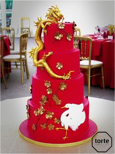 CHINESE DRAGON Dramatic red and gold Chinese dragon wedding cake with cherry blossoms and a lucky stork #wedding #weddingcake #cheshireweddings #red #dragon #sugarmodelling #cherryblossom #gold #website