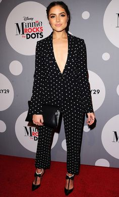 OLIVIA CULPO OLIVIA CULPO in an ultra-plunging black-and-white polka-dot two-piece suit, which she accessorizes with bow tie-adorned ankle-strap heels and an oversize clutch at the Minnie Mouse Rocks the Dots Art and Fashion exhibit in L.A. Credit:Sara De Boer/Startraks Updated: Monday Jan 25, 2016 | 11:44 AM EST