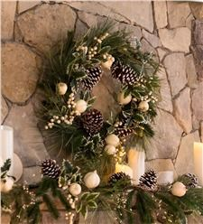 "Plow & Hearth -  Elegant ""Winter White"" Wreath.  $59.95  Natural pine cones, faux greenery, gourds & holly leaves are tipped in white to give a snow-kissed effect upon a natural rattan base.  Light NOT included.  24"" diameter.  Safe for covered outdoor display."