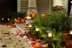 Fall decorated porch...from HGTV. Nice!