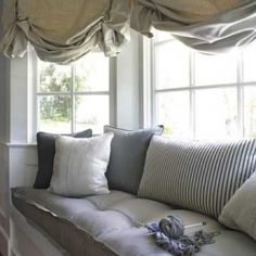 Inspiring window seat designs - functional for both storage and seating!