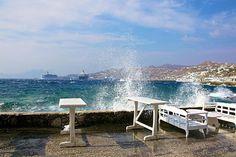 Small waves from the Aegean Sea splash water on shoreline tables in Santorini, Greece... #shutterbugpix #photooftheday #photo #travel #travelgram #travels #travelchannel #natgeo #worldtraveler #santorini #greece