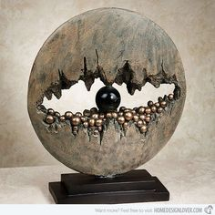 This piece could be a representation of an eye and the way the negative space makes the Sculpture look more interesting