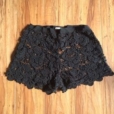 Free People Chemical Lace Tap Shorts Black. Size in unmarked but I think they're an XS/S.  They snap up the side. Have a ribbon waist band. There's a little part of the lace in the back that looks loose but hasn't detached or unraveled. Photo'd. Great for layering. Free People Shorts