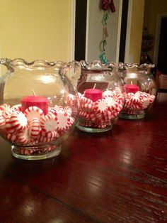 "Peppermints in small ""fish bowls"" with candles. Super cute table decor for Christmas!!:"