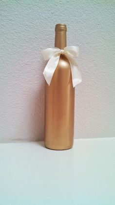 Gold Upcycled Painted Wine bottle wedding by atasteofeverything