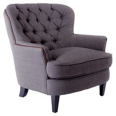 Bring stately appeal to your living room seating group or favorite reading nook with this handsome arm chair, showcasing tufted grey linen upholstery and nai...