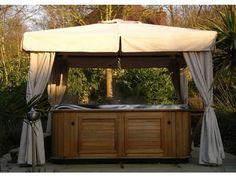 Hardwood Gazebo x This Hardwood Gazebo is a deluxe gazebo with a hardwood frame. In the photo above it is shown being used as a hot tub gazebo, but it can equally be used to provide shade to… Wooden Garden Gazebo, Patio Gazebo, Diy Pergola, Backyard Patio, Gazebo Curtains, Outdoor Curtains, Hot Tub Garden, Diy Garden, Garden Ideas
