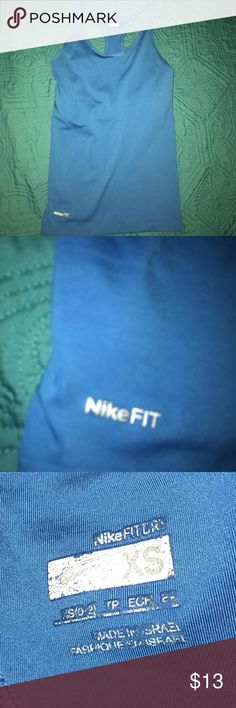 Blue nike tank top Blue Nike tank top with built-in bra. In great condition only worn once. Nike Tops Tank Tops