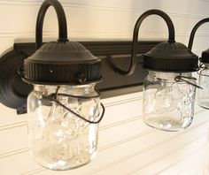 Never thought to swap the globes from a light fixture for Mason jars....cute for an outdoor patio or courtyard :)