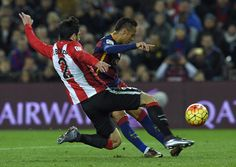 Barcelona's Brazilian forward Neymar (L) scores past Athletic Bilbao's defender Eneko Boveda during the Spanish league football match FC Barcelona vs Athletic Club Bilbao at the Camp Nou stadium in Barcelona on January 17, 2016.