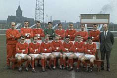 Manchester United at Old Trafford, 17 February 1965:  Back row, left-to-right: Jack Crompton (trainer), Bill Foulkes, David Sadler, Pat Dunne, Shay Brennan, Graham Moore, Pat Crerand, Noel Cantwell, and Matt Busby (manager); front row, left-to-right: John Connelly, Nobby Stiles, Bobby Charlton, Denis Law, Tony Dunne, David Herd, and George Best. They were League Division One champions for the season 1964-1965   ... ♫♩♬♪  those were the days, my friend ... ♫♬♪