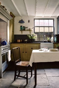 The kitchen table dates from the same period as the house and was here when Pedro moved in; the chair is from Spitalfields Market.