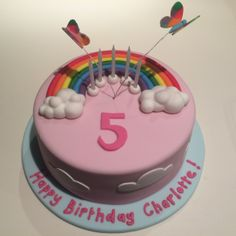 Rainbow and butterfly cake for Charlotte 6 layer vanilla rainbow cake with fondant rainbow, clouds and butterfiles $190
