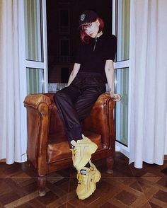 Me posing on a chair in front of the window in my hotel room - wearing @buffaloclassics & @rainsjournal #ootn ...and @claudevandamn took this picture. #mfw