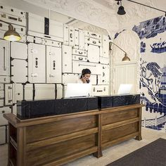 amazing reception desk wall made with white suitcases #decor #wall #creative #hotel